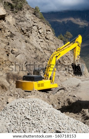 Heavy road construction elevator machine in Himalaya mountains. India, Ladakh, altitude 3400 m - stock photo