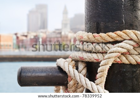 Heavy ropes secure a ship on the Charlestown side of Boston Harbor - stock photo