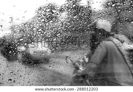 Heavy rush hour traffic in the rain,View through the window and Shallow depth of field composition. - stock photo