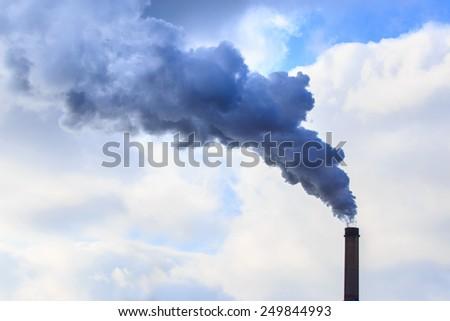 Heavy smoke and coal powered plant stacks - stock photo