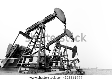 Heavy steel machines pumping oil. - stock photo