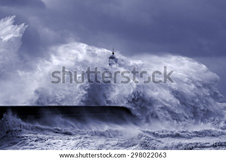 Heavy storm at the mouth of Douro river, Porto, Portugal. Black and white toned blue. - stock photo