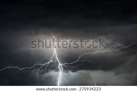 Heavy storm bringing thunder, lightnings and rain in spring. - stock photo