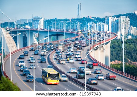 heavy traffic closeup in bridge and graceful curve shape,xiamen, China - stock photo