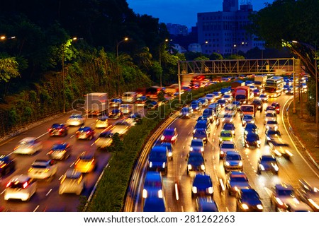 heavy traffic moving on the road in twilight, Kuala Lumpur - stock photo