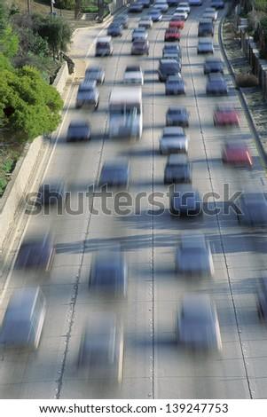 Heavy traffic on a freeway - stock photo
