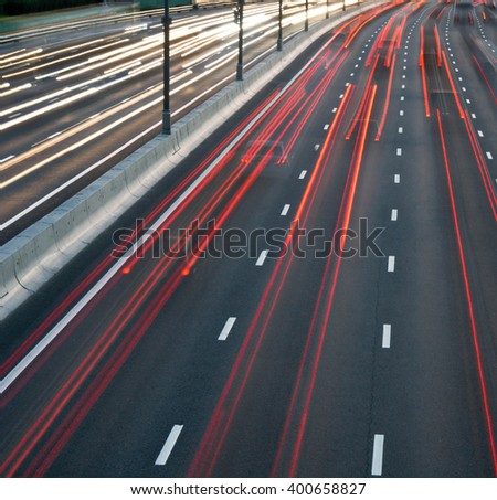 heavy traffic on the highway in the evening - stock photo