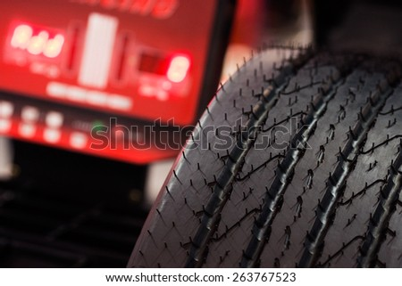 Heavy vehicle tire check on balancing machine - stock photo
