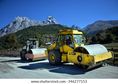 Heavy Vibration roller at asphalt pavement works (road repairing) - stock photo