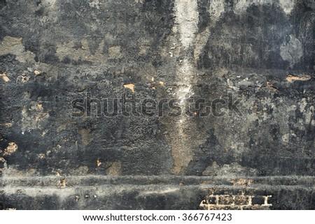 Heavy worn black building wall.  - stock photo