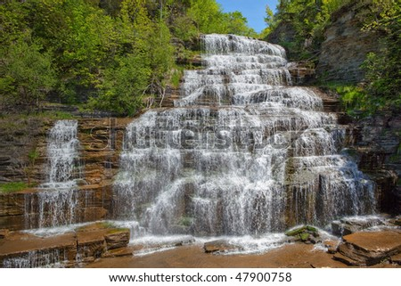 Hector Falls is a near the town of Burdett, in Schuyler County, New York state, USA.  This beautiful waterfall is on Route 414, 3 miles north of Watkins Glen. - stock photo