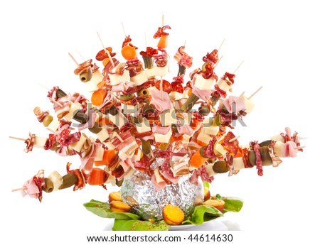 hedgehog made from sticks with delicious food - isolated on white - stock photo