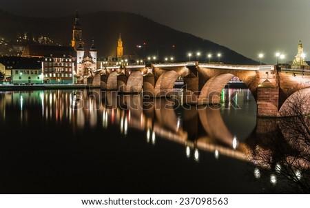 Heidelberg's old bridge reflecting at night - stock photo