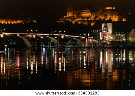 Heidelberg's old city, the castle and the Neckar river at night - stock photo