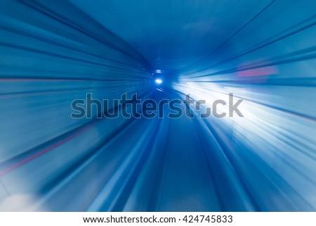 Heigh velocity speeding underground train long exposure - stock photo