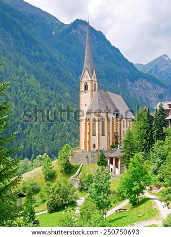 HEILIGENBLUT, AUSTRIA - 27 June 2014: The gothic pilgrimage church of Heiligenblut is a landmark in Carinthia.  - stock photo