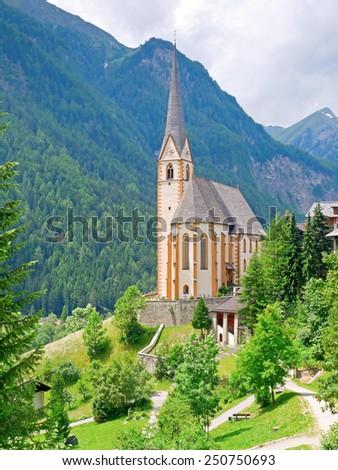 HEILIGENBLUT, AUSTRIA - 27 June 2014: The gothic pilgrimage church of Heiligenblut is a landmark in Carinthia.  - stock photo