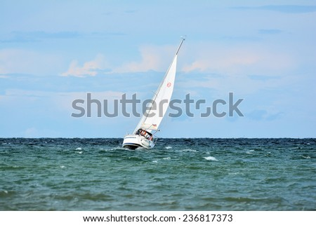 HEILIGENDAMM, GERMANY - August 23, 2014: Sailboat in the Baltic Sea at Heiligendamm - stock photo