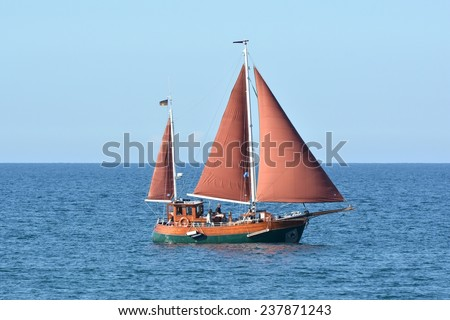HEILIGENDAMM, GERMANY - August 28, 2014: sailing boat on the waters of the Baltic Sea on the shore Heiligendamm - stock photo