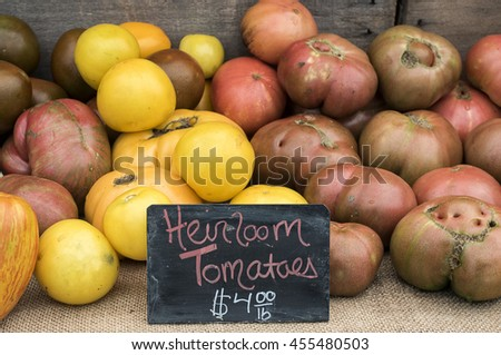 Heirloom tomatoes for sale at local farm market. - stock photo