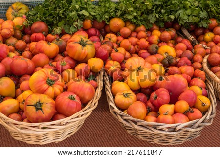 Heirloom Tomatoes in Baskets - stock photo