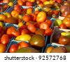 Heirloom tomatoes in baskets at farmers' market - stock photo