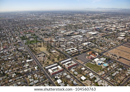 Helicopter aerial of downtown and surrounding neighborhood in Mesa, Arizona - stock photo