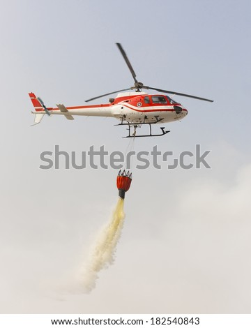 Helicopter  extinguishing a fire - stock photo