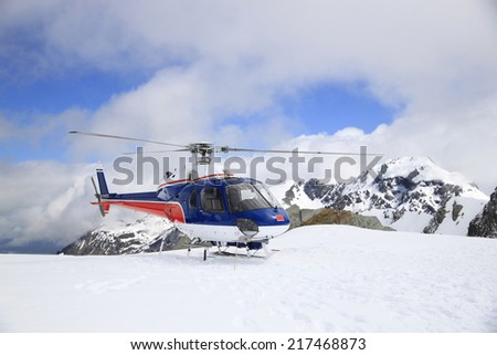 Helicopter fight over Fox and Franz Josef Glacier, New Zealand - stock photo
