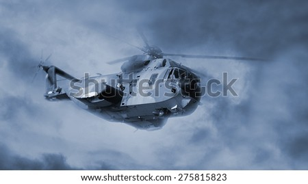 helicopter in flight with cloudy sky - stock photo