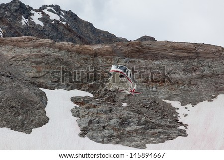 helicopter in mountains - stock photo