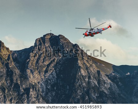 Helicopter on a rescue mission in the Tatras Mountains. - stock photo