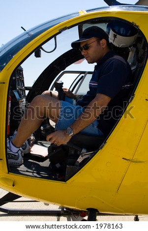 Helicopter pilot in the cockpit. - stock photo