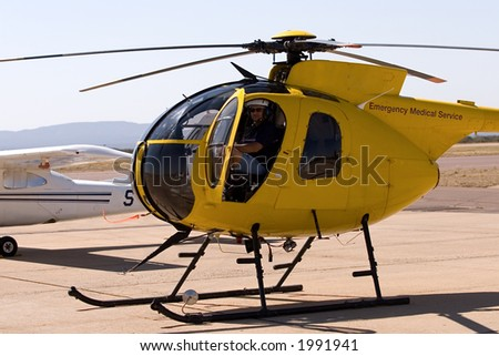 Helicopter pilot in the cockpit - stock photo