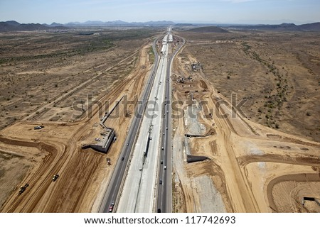 Helicopter view of construction along Interstate 17 freeway in Phoenix, Arizona - stock photo