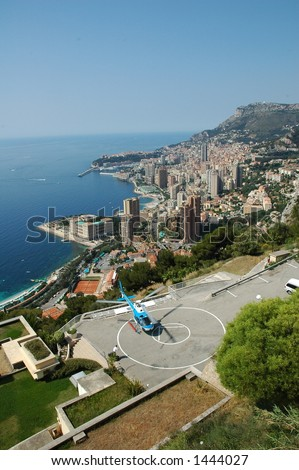 Helicopter waiting for passengers in front of the skyline of Monaco - stock photo