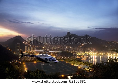 Helicopter with  Rio De Janeiro in background. - stock photo