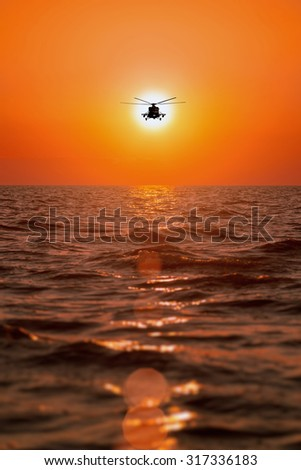 helicopters, warm sunset - stock photo