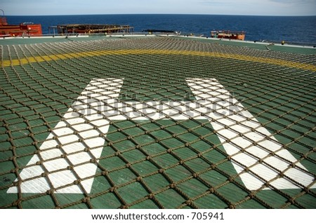 Helipad on offshore oil rig - stock photo