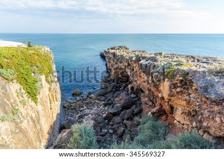 Hell's Mouth is a chasm located in the seaside cliffs close to the Portuguese city of Cascais, in the District of Lisbon - stock photo
