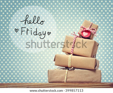 Hello Friday message with stack of gift boxes - stock photo