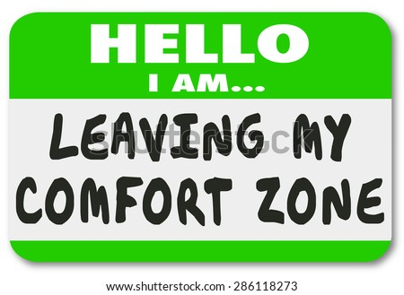 Hello I Am Leaving My Comfort Zone name tag sticker to illustrate bravery and courage in going beyond the familiar to new experiences and growth - stock photo