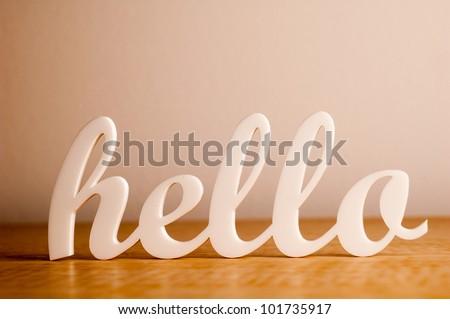 Hello on Wooden Table - stock photo