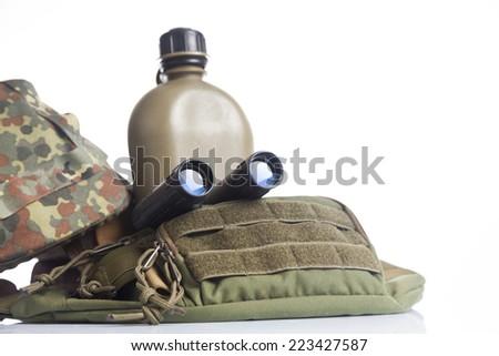 helmet, binoculars and canteen - stock photo