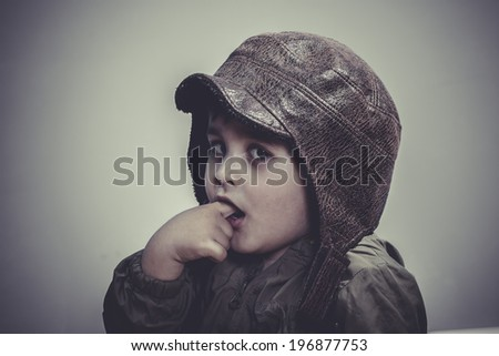 helmet, fun and funny child dressed in aviator hat and goggles - stock photo
