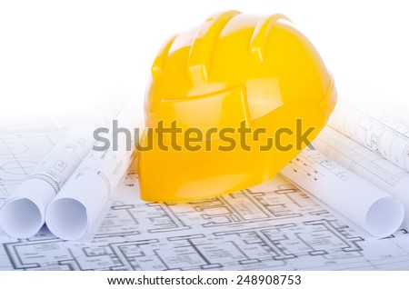 Helmet on the construction drawings. - stock photo