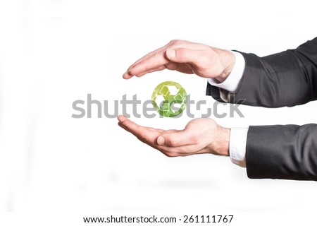 Help and care for recycling. Business man hands isolated on white with recycle icon in the middle. Go green.  - stock photo