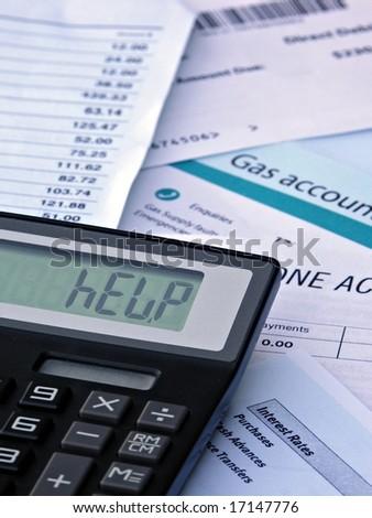 HELP - Calculator and bills - stock photo