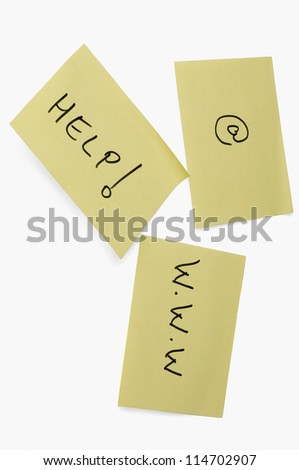 Help text and at symbol with www on adhesive notes - stock photo