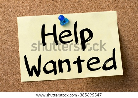 Help Wanted - adhesive label pinned on bulletin board - horizontal image - stock photo